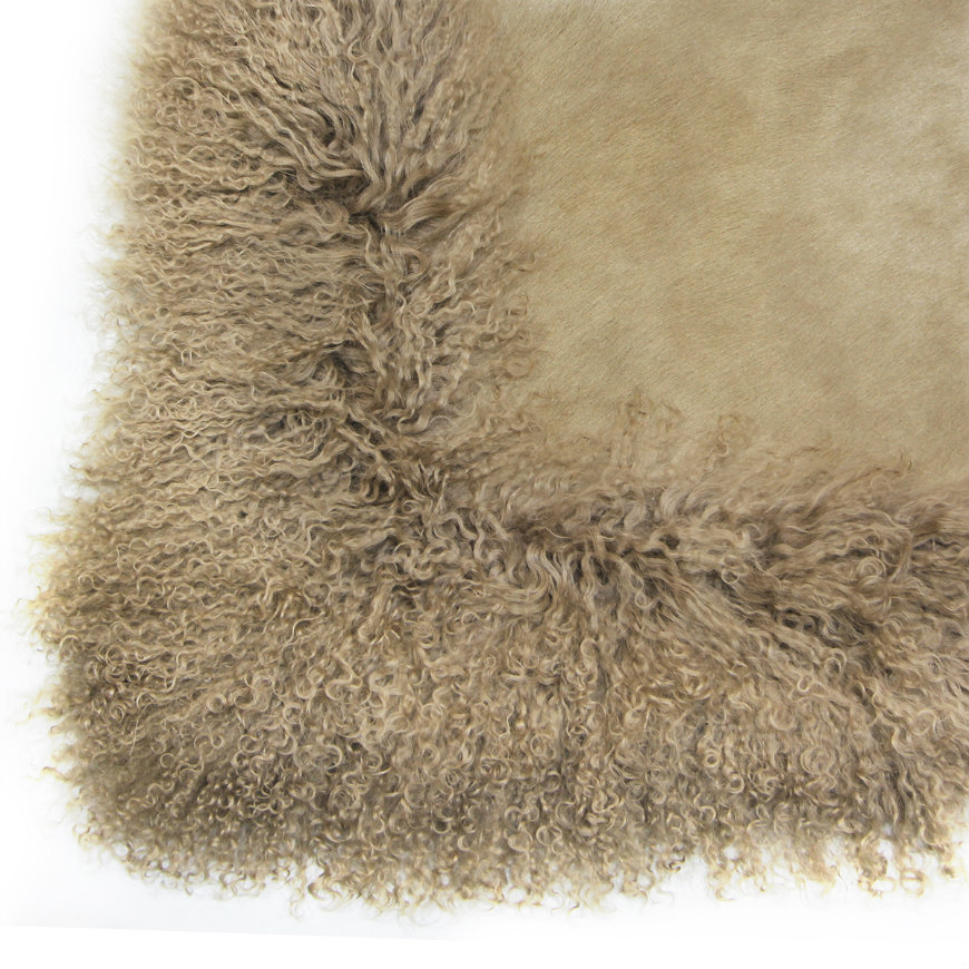 cowhide-with-mongolian-goat-rug-6 contemporary rugs 10 Contemporary Rugs to Create a Charming Ambience in Your Bedroom cowhide with mongolian goat rug 6